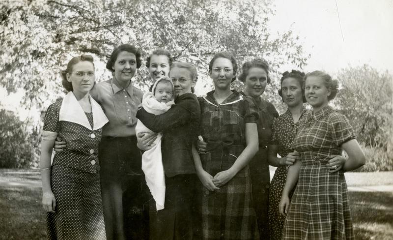 """Baby Ned"" and his caregivers, from the scrapbook created during his first year, spent on the Iowa State campus in 1938-1939"