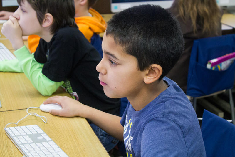 To program an artist to draw connecting lines, Ike Alexander, a fifth grader at Sawyer Elementary, has to figure out the correct angles to use.