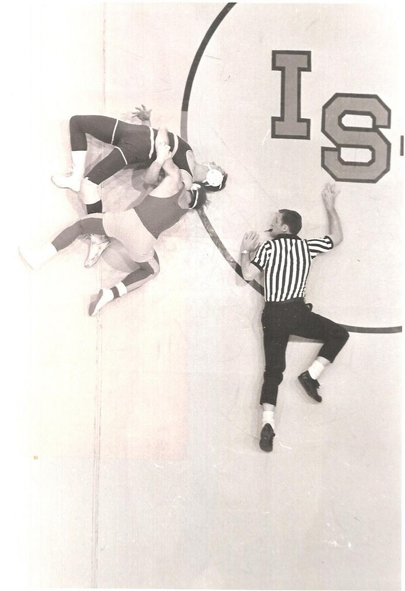 Dan wrestles a Drake University student in the late 1960's at the old Iowa State University Armory