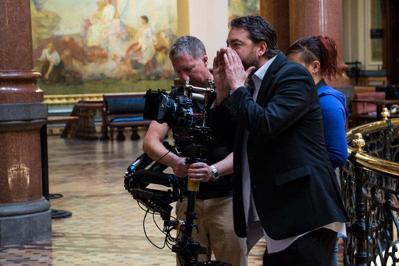 "Brent Roske directing a scene in Iowa's Capitol for his new film ""Courting Des Moines."""