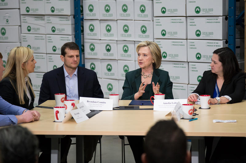 Former Secretary of State Hillary Clinton speaks to a group of small Iowa business owners at Capital City Fruit in Norwalk, as part of her first week of campaigning as a presidential candidate.