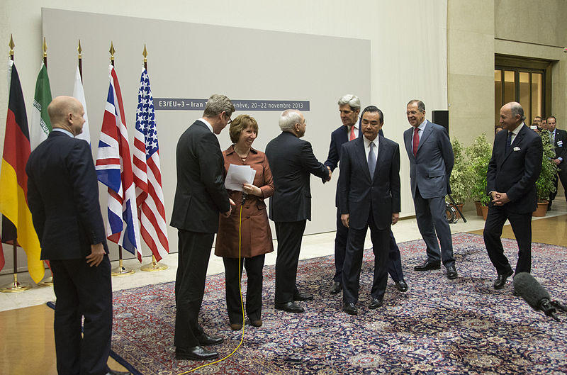 U.S. Secretary of State John Kerry shakes hands with Iranian Foreign Minister Javad Zarif after the P5+1 and Iran concluded negotiations about Iran's nuclear capabilities on November 24, 2013.