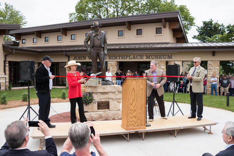 Cutting the ribbon during the grand opening ceremony. Left to right: Barry Corbin (actor & Birthplace board member), Aissa Wayne (John Wayne's daughter), Joe Zuckschwerdt (Birthplace & Museum President), and Christopher Mitchum (actor).