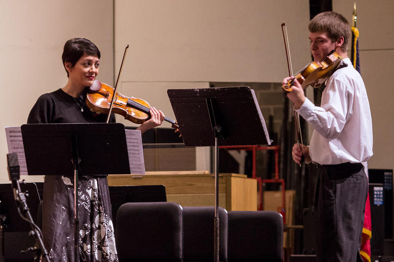 During a workshop in October, visiting violinist Anne Akiko Meyers offers advice to Des Moines Youth Symphony musician Destry Klein as they perform sections of Vivaldi's The Four Seasons.