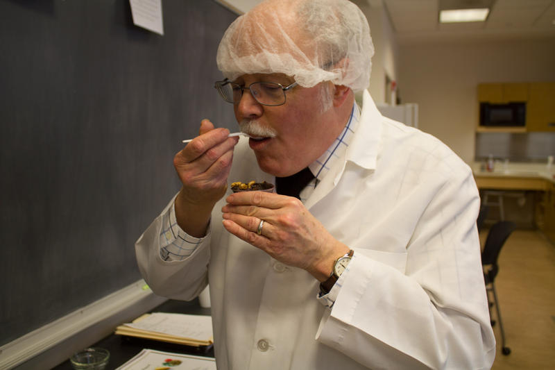 Professor Lester Wilson samples an early iteration from one of the student groups developing new food products.
