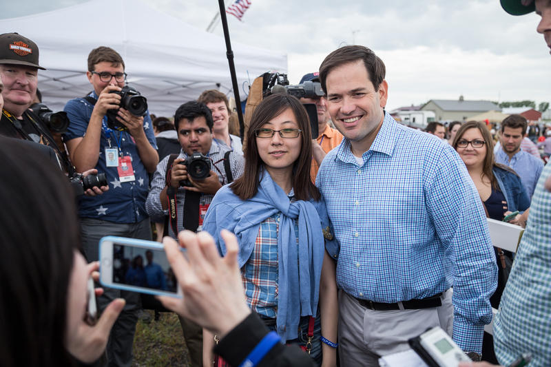 Florida Senator Marco Rubio poses with visitors at Joni Ernst's Roast and Ride fundraiser in Boone, Iowa.