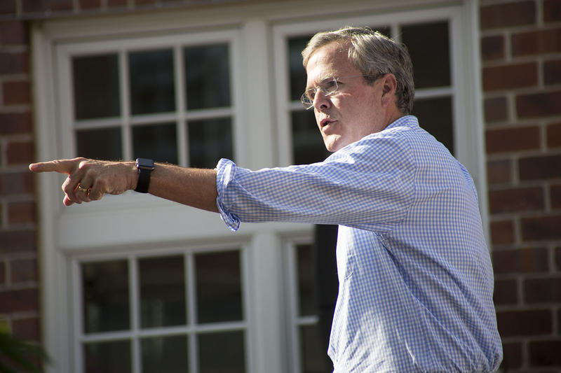 Former Florida Governor Jeb Bush takes questions from the audience at a town hall-style campaign event in Pella, Iowa.