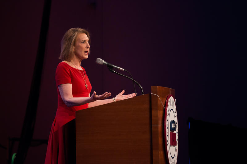Former business executive, Carly Fiorina speaks to a crowd at the Iowa GOP's Lincoln Dinner