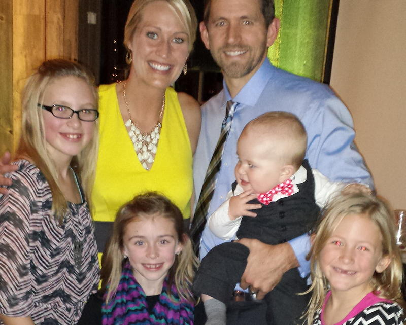 Rachel and Tim Scheib of Des Moines and their blended family.