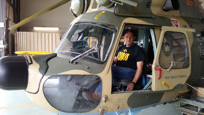 Tom Schnell sitting in the cockpit of a helicopter, built in 1978 in Poland, that now contains equipment seen in an advanced Boeing CH-47 Chinook