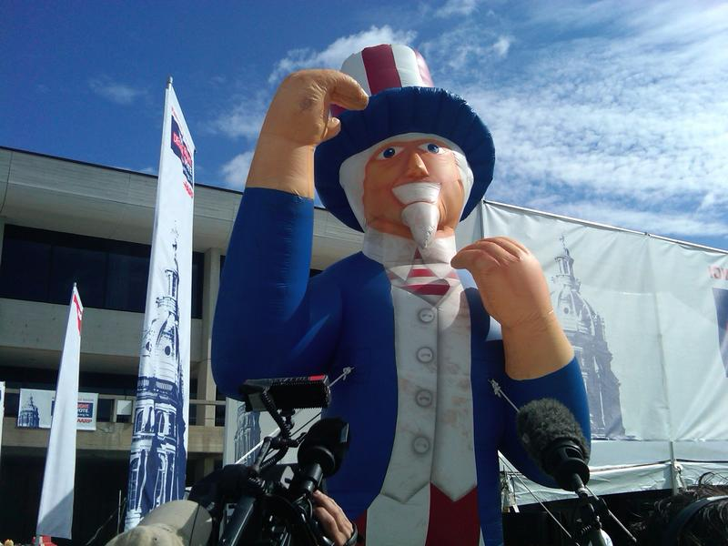 An Uncle Sam inflatable towers over the 2011 Iowa Straw Poll