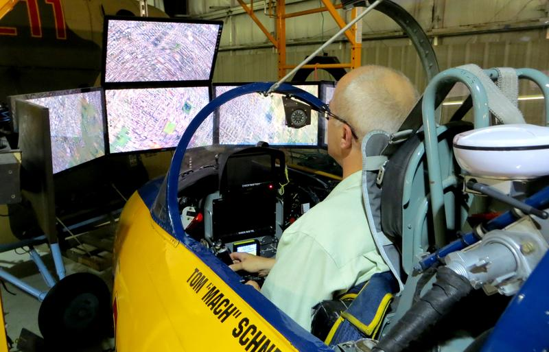 "Ben Kieffer uses a training simulator in a full functioning L29 aircraft, ""flying"" over Rhode Island with the help of Tom ""Mach"" Schnell"