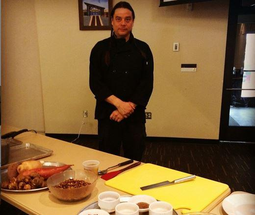 Chef Sean Sherman preparing for a food demonstration