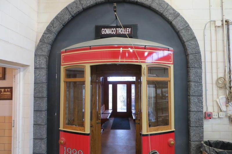 A trolley car entrance greets Gomaco visitors