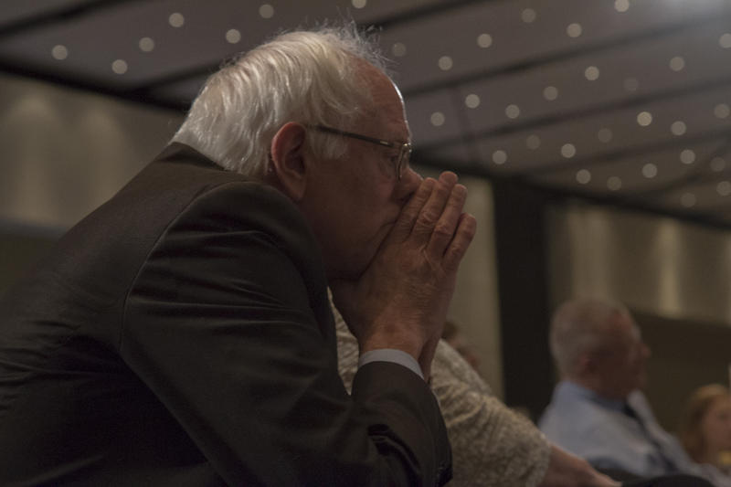 Democratic Presidential candidate Senator Bernie Sanders listens to other candidates at the Iowa Democratic Party's Hall of Fame Dinner in Cedar Rapids on July 17, 2015.