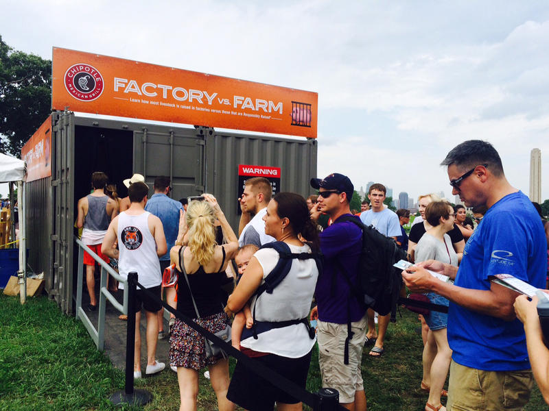 People attending a Chipotle Cultivate Festival in Kansas City in July lined up for an exhibit on what is often called factory farming, or the industrial agriculture system. Attendees needed to go through four exhibits to get a free burrito.