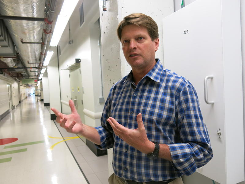 Monsanto's head of Global Regulatory Affairs, Ty Vaughn, speaks to a group of journalists during a National Press Foundation tour.