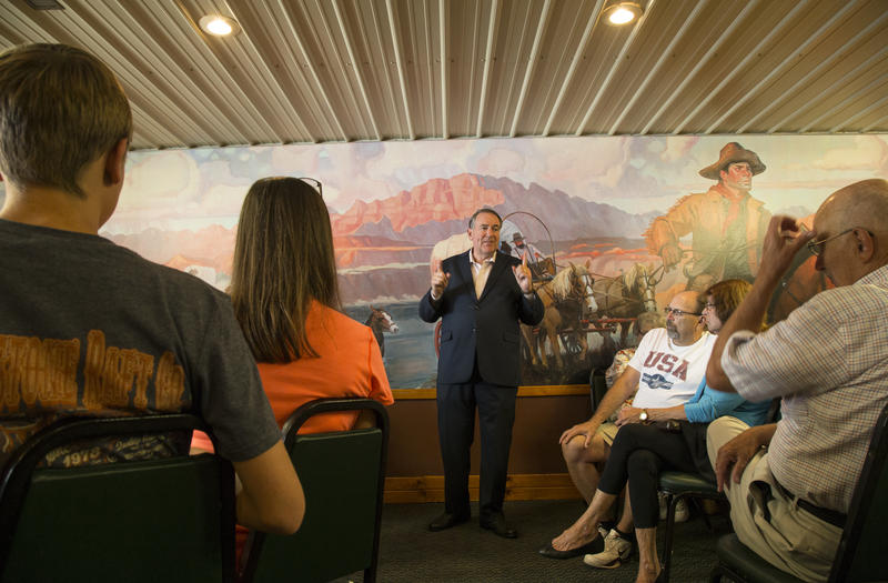Former Arkansas Governor Mike Huckabee talks to Iowans at the Pizza Ranch in Jefferson, Iowa on July 30, 2015.