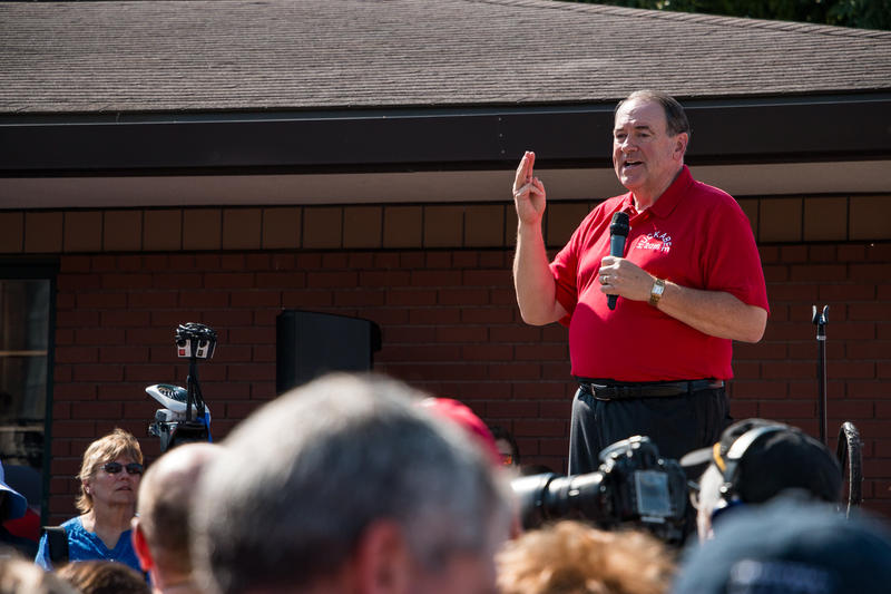 Arkansas Governor Mike Huckabee makes a joke about campaigning for president at Pizza Ranches during his speech at the Iowa State Fair.
