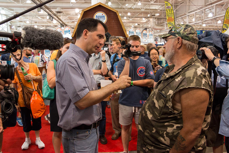 Wisconsin Governot Scott Walker speaks with a veteran during his visit to the fair.
