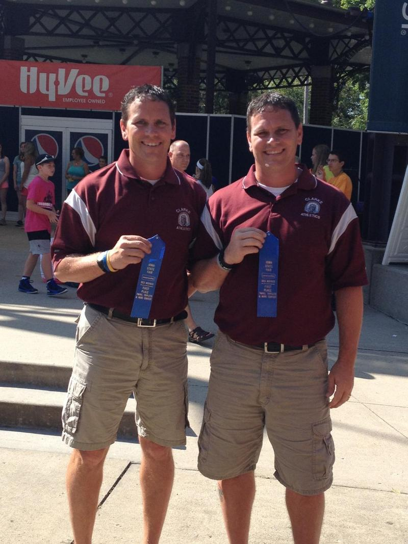 "Don and Doug May pose with their blue ribbons from this year's ""Twins, Triplets and More"" contest at the Iowa State Fair"