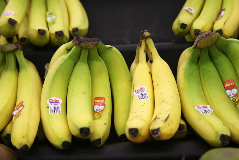 The bananas on the right will likely get dumped into the compost pile because most consumers, like those at this Kansas grocery store, prefer to buy pristine produce.