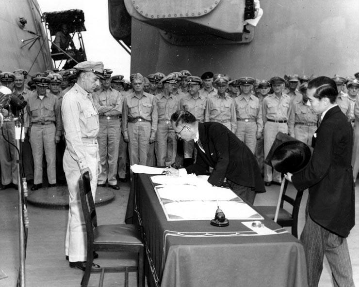 Japanese Foreign Minister Mamoru Shigemitsu signing the Instrument of Surrender on behalf of the Japanese Government, formally ending World War II