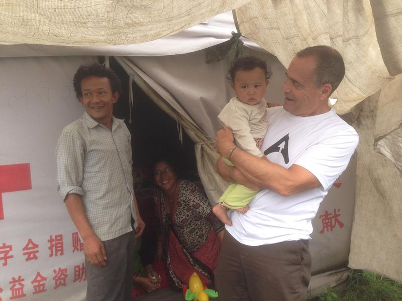 Dr. Deming visiting a Red Cross tent village for earthquake survivors in Kathmandu.