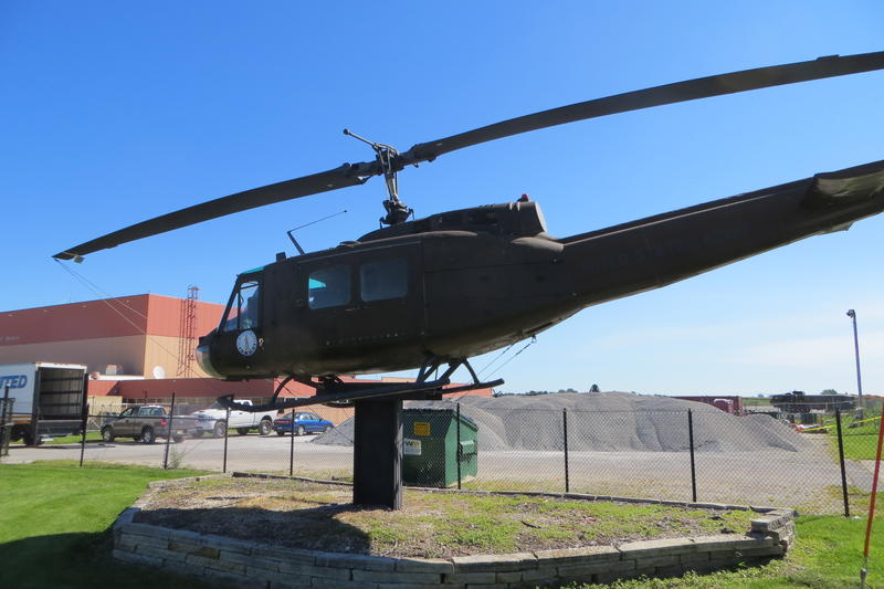 A Vietnam War era Huey helicopter outside the Boone Armory gate.