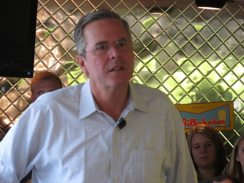 GOP presidential hopeful Jeb Bush meets supporters at a Waterloo diner Tuesday.