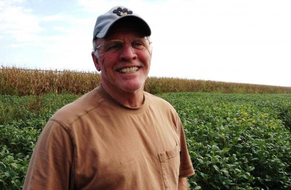 Fifth-generation farmer Richard Oswald stands in a field of soybeans that's worth a lot less than it would have been last year, partly thanks to a downturn in the economy of China.