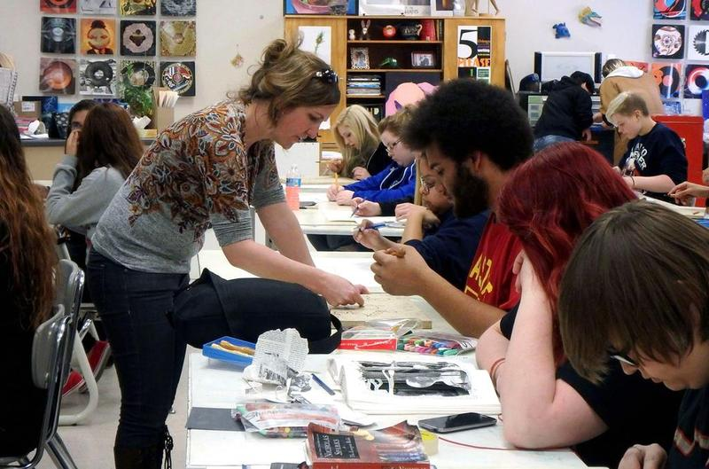 Jennifer Drinkwater teaching high school students and local artists the art of printmaking for a steamroller printmaking event in Perry.