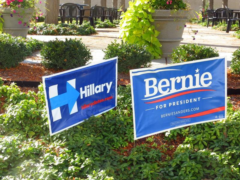 Yard signs lining a downtown Des Moines street