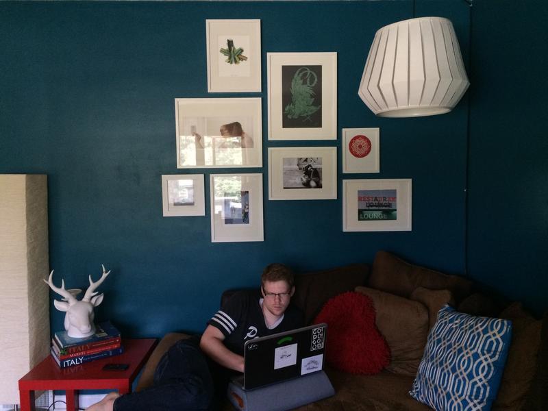 Dani Ausen's husband Ken Sturgis hangs out in the couple's livingroom.