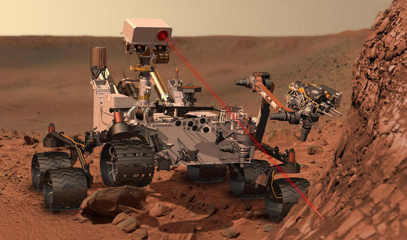 "This artist's concept depicts the rover Curiosity, of NASA's Mars Science Laboratory mission, as it uses its ""Chemistry and Camera"" instrument to investigate the composition of a rock surface."