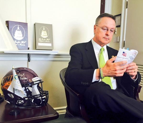 Iowa Republican first district Congressman Rod Blum, reading the constitution