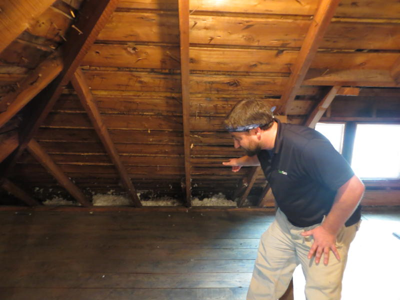 Home energy specialist Jason Jefferson shows where heat can leak from the attic