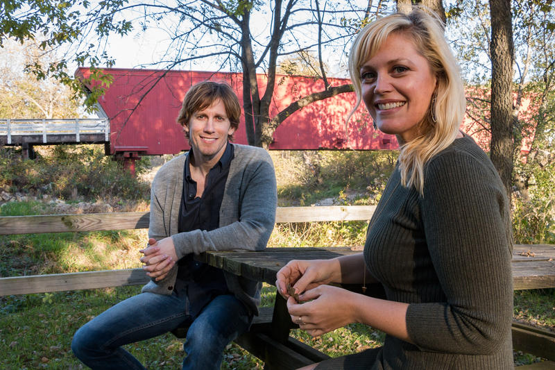 Lead actors for the touring version of The Bridges of Madison County musical, Andrew Samonsky and Elizabeth Stanley visit the Roseman Covered Bridge in Winterset.