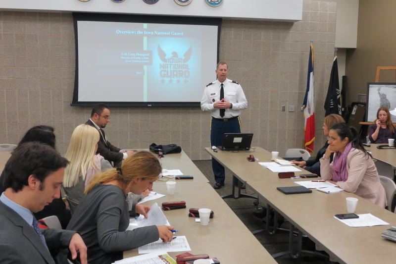 The Kosovar VIPs learn about the Iowa National Guard from Lt. Col. Mike Wunn.
