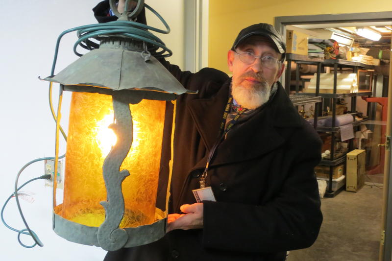 John Zickefoose holds one of the original copper lanterns waiting to be reinstalled later.