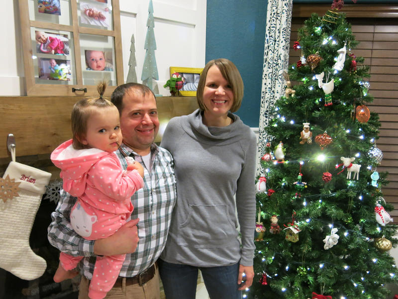 The Abrams family, from left, Eisley, Brian and Katie, in Fort Collins, Colorado, opts for an artificial tree for their annual Christmas tradition.