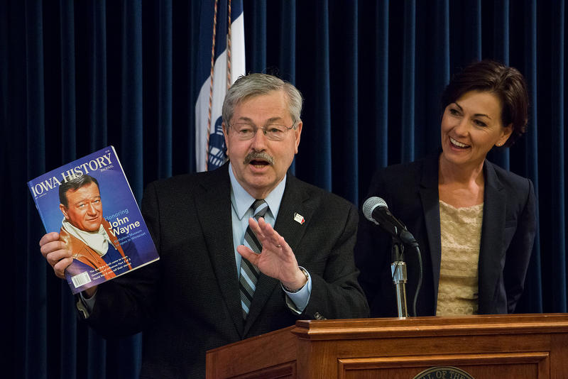 Governor Terry Branstad holds The Iowa History Journal featuring a cover story about the new John Wayne Birthplace Museum in Winterset. 5/11/2015