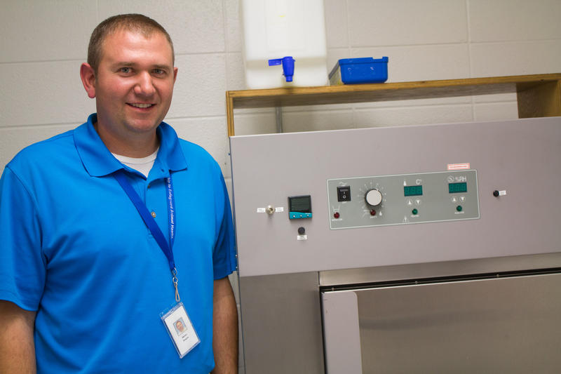 At the SDSU Animal Disease Research and Diagnostic Laboratory, Aaron Singrey programmed this environmental chamber to reflect temperature and humidity changes over a 37-day period and in locations from China to Des Moines.