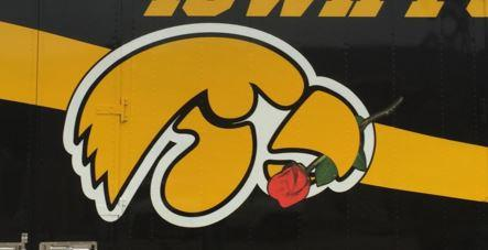 Two Iowa fans donate their time, truck and money to haul the hawkeye's gear around the country. They gave the 18-wheeler a special paint job for the Rose Bowl.