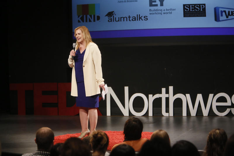 Michele Weldon addresses a lecture hall during a Ted Talks lecture.