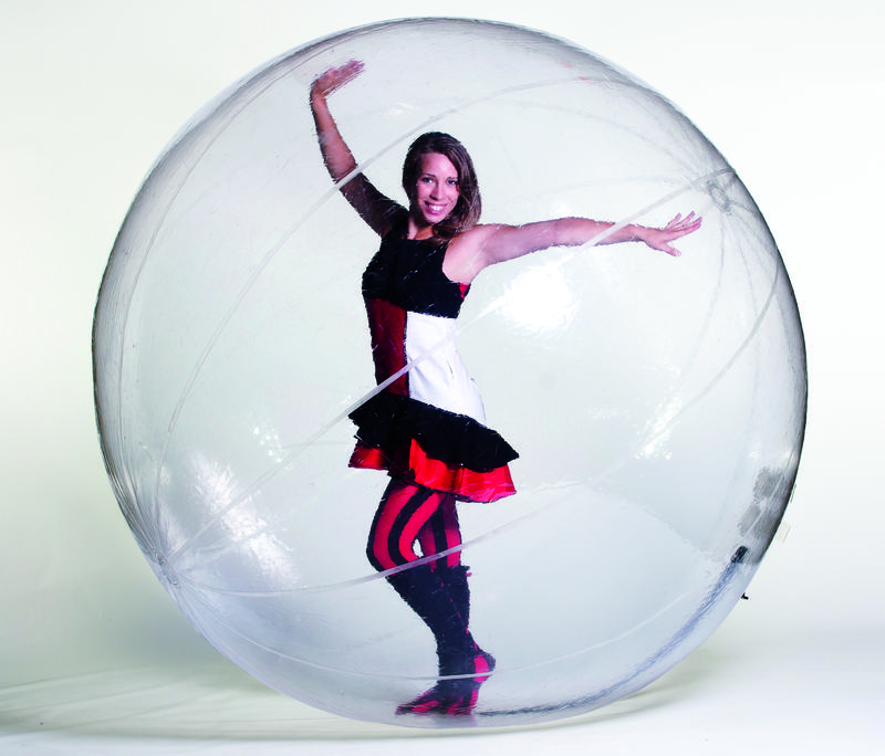 Laura Ersnt poses in her hamster ball