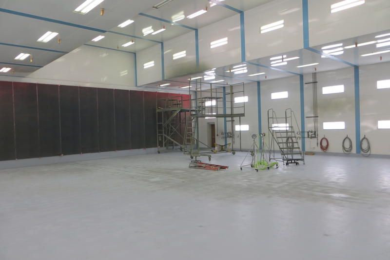 The empty paint booth where aircraft are sprayed by hand.