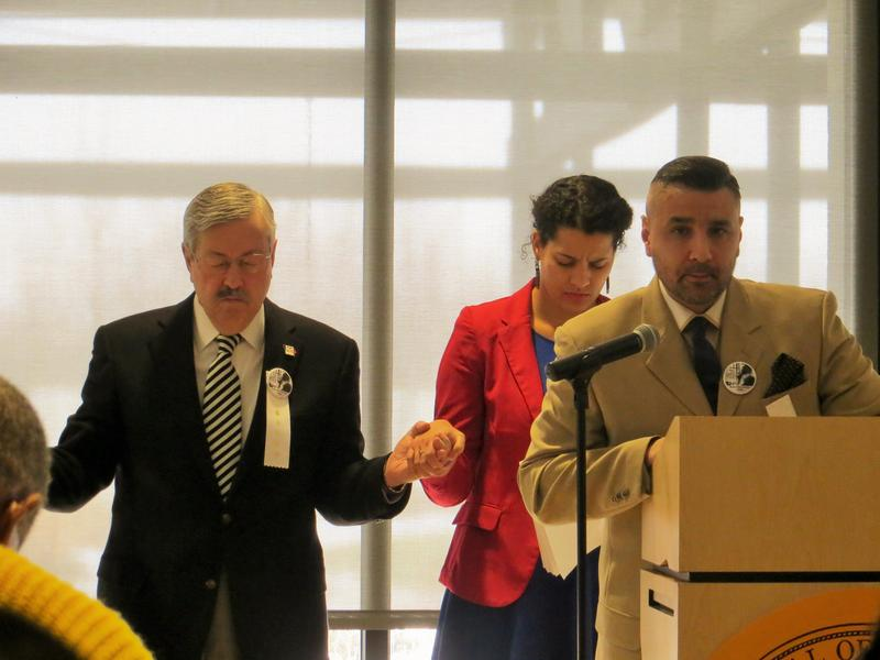 Gov. Branstad, Des Moines School Board Member Dionnal Langford, and Pastor Alfonso Perez of the New Life Miracle Church in Des Moines at Monday's MLK Day celebration.
