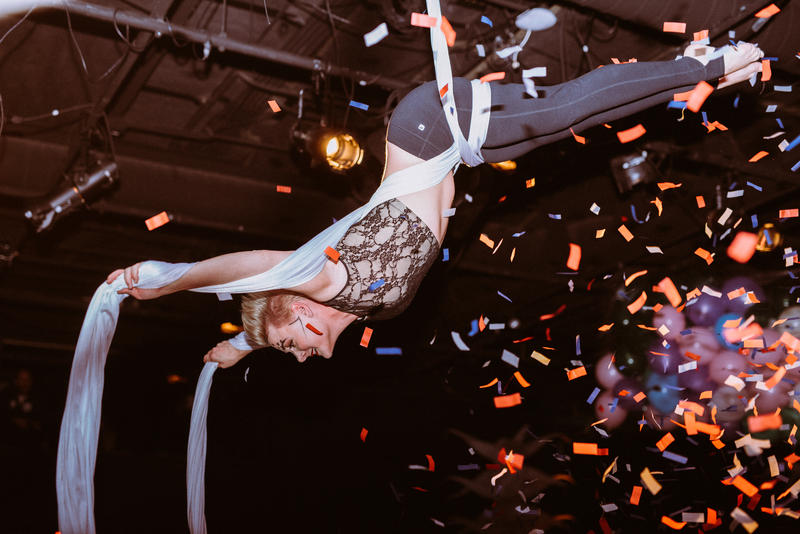Felicia Coe performs a human ball drop at the Des Moines Social Club