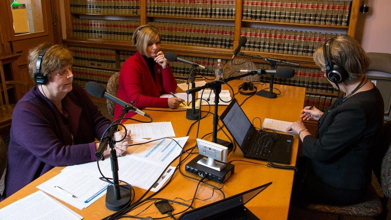 Joyce Russell talks with Rep. Linda Miller and Sen. Liz Mathis at the law library at the Iowa Statehouse